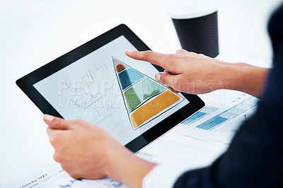 Buy stock photo Cropped image of a businesswoman working on a digital tablet