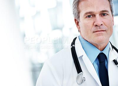 Buy stock photo A mature doctor looking at the camera