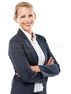 Buy stock photo A smiling young businesswoman standing with folded arms