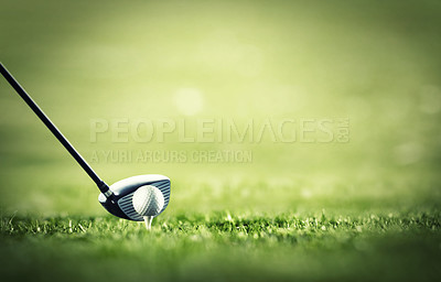 Buy stock photo A golf club ready to tee-off with a white ball on a golf course