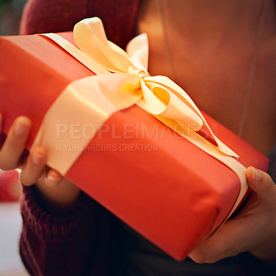 Buy stock photo Closeup shot of a woman holding a present wrapped in a bow