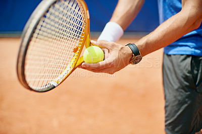 Buy stock photo Cropped shot of a tennis player ready to serve