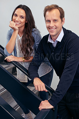Buy stock photo Portrait of two business colleagues standing in a stairwell