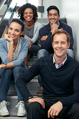 Buy stock photo Portrait of a group of office coworkers sitting in a stairwell