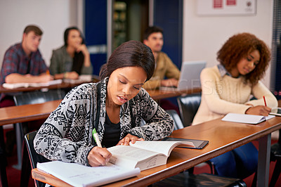 Buy stock photo Shot of students working diligently in class