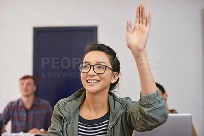 Buy stock photo Shot of a young woman raising her hand to ask a question in class