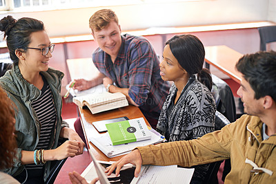 Buy stock photo Overhead shot of students hanging out together between class
