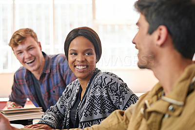 Buy stock photo Shot of students chatting happily together in class