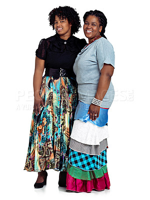Buy stock photo Studio shot of two african women standing against a white background