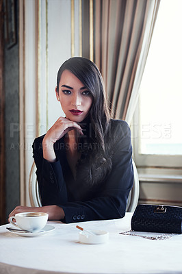 Buy stock photo Portrait shot of an elegant young woman with coffee and a cigarette