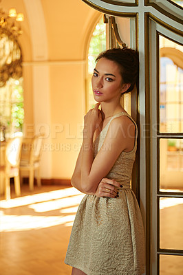 Buy stock photo A beautiful and elegantly dressed young woman standing  in her stylish home