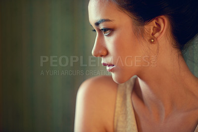 Buy stock photo Profile shot of a beautiful young woman dressed elegantly indoors