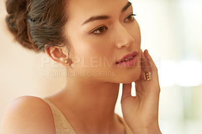Buy stock photo Cropped shot of a beautiful young woman dressed elegantly in gold