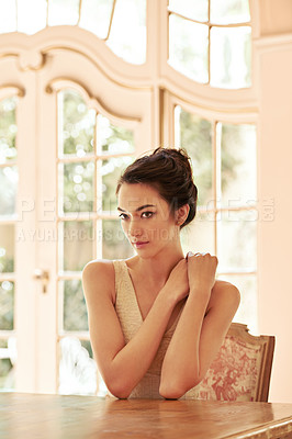 Buy stock photo Shot of a beautiful young woman dressed elegantly in her home