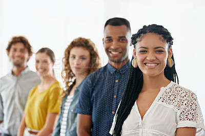 Buy stock photo Cropped portrait of a group of young coworkers standing against a white background