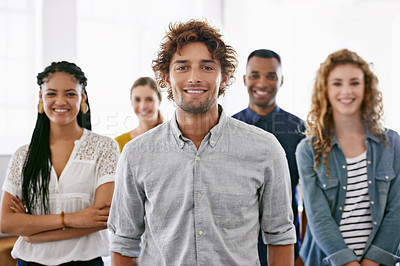 Buy stock photo Cropped portrait of a group of young coworkers standing in a brightly lit office