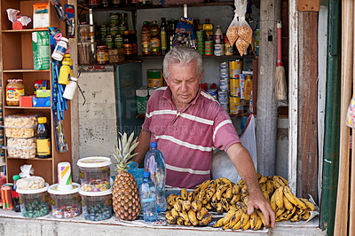 Buy stock photo Shot of a street vendor selling a variety of food at his stall