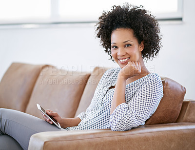 Buy stock photo Portrait of an attractive woman sitting on the sofa with her smartphone