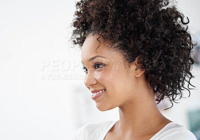 Buy stock photo Shot of an attractive young woman standing in the office. The commercial designs displayed in this image represent a simulation of a real product and have been changed or altered enough by our team of retouching and design specialists so that they are free of any copyright infringements