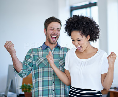 Buy stock photo Shot of a excited coworkers cheering in an office