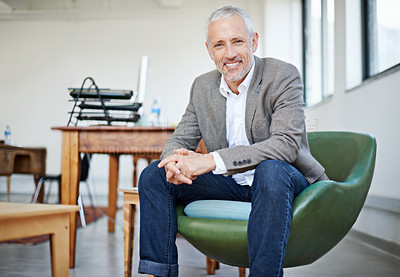 Buy stock photo Portrait of a mature businessman sitting in a chair in an office