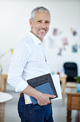 Buy stock photo Portrait of a mature businessman standing in an office