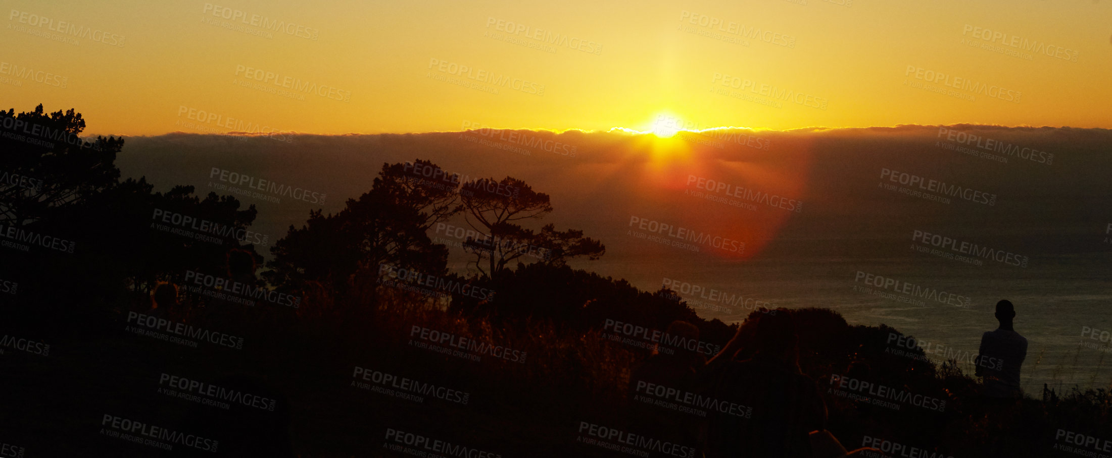 Buy stock photo A beautiful view of a golden sunset from a hilltop