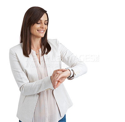 Buy stock photo Studio shot of an attractive mature woman checking the time on her wristwatch