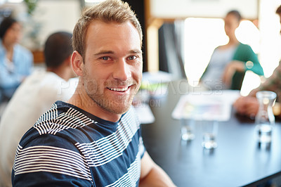 Buy stock photo Portrait of a male designer in a meeting with his colleagues in the background