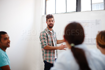Buy stock photo Shot of a team of young designers in a brainstorming session