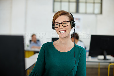Buy stock photo Shot of a beautiful woman wearing a headset while working at her desk in the office
