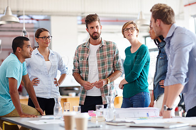 Buy stock photo Shot of a group of young designers having a brainstorming meeting