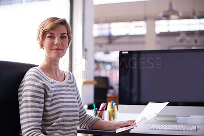 Buy stock photo Portrait of an attractive designer working at her desk