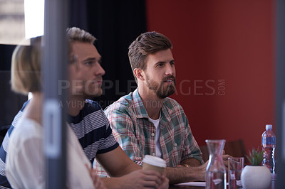 Buy stock photo A group of informal businesspeople in a meeting