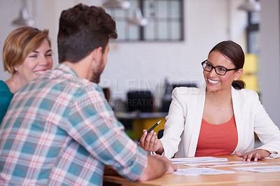 Buy stock photo Cropped shot of businessmen and businesswoman in a meeting