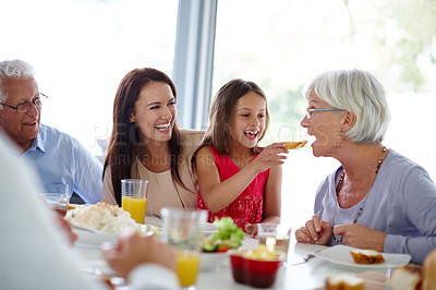 Buy stock photo Shot of a happy multi-generational family having a meal together
