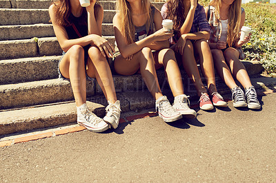 Buy stock photo Shot of a group of friends sitting together on the steps outside