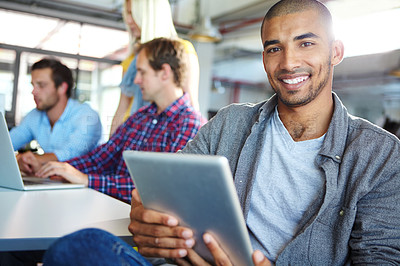 Buy stock photo Portrait of a designer using a digital tablet with colleagues in the background