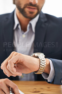 Buy stock photo Cropped shot of a businessman checking the time on his watch