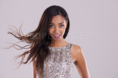 Buy stock photo Studio shot of a gorgeous  young woman posing in evening wear against a gray background