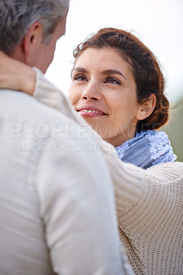 Buy stock photo Shot of a mature loving couple standing face to face and embracing