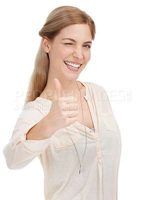 Buy stock photo Studio shot of an attractive young woman giving you thumbs up against a white background