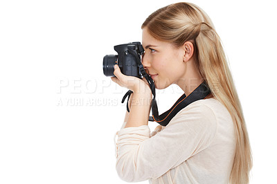 Buy stock photo Studio shot of a beautiful young woman taking pictures with her camera against a white background