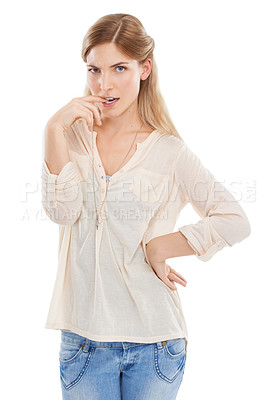 Buy stock photo Studio shot of a beautiful young woman looking unsure against a white background