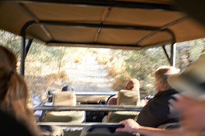 Buy stock photo A blurred photo of a group of people in a safari jeep