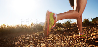 Buy stock photo Cropped shot of a woman running on off road terrain