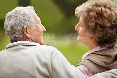 Buy stock photo Rear view of a happy mature couple looking at each other - Outdoor