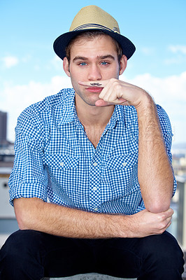 Buy stock photo Portrait of a handsome hipster with a finger mustache
