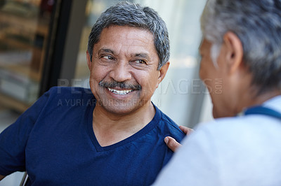 Buy stock photo Cropped shot of a senior man with his doctor