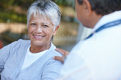 Buy stock photo Cropped portrait of a senior woman talking to her doctor